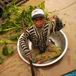 A young girl with her pet snake that we saw while visiting a water village outside Siem Reap