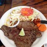 Steak enchilada plate