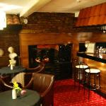 a welcoming bar awaits you to pick your meal on large carver chairs