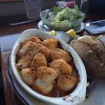 baked scallops with baked potato and small salad