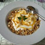 Homemade muesli with honey, yogurt, and banana