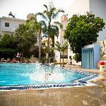 Enjoying a splash around the pool