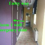 entry way with emergency door to room 1