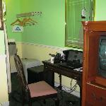 Note the missing desk knob and peeled veneer under the TV. Chair wobbled. Cramped, unpleasant ro