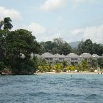 View from the water of the beach. Hotel rooms are in the background. Beach bar is not far away.