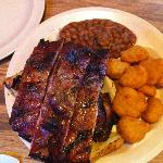 Ribs and chicken combo on garlic toast with corn nuggets and baked beans