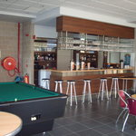 A well stocked bar with pool & football table!