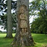 carving of a piper in the tree!