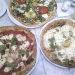 Trio of pizzas: meatball, clam, and heirloom tomato with spinach