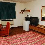 Stained carpet, worn furniture.  Fridge and mircoware