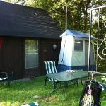 solar shower and back of camping cabin