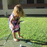 My granddaughter golfing right behind our room