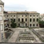 View from the window - derelict building and concrete yard