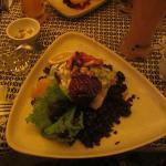 Main entree of free range turkey, wild rice, and beat salad