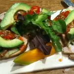 Roasted turkey and avocado tartine with whole grain mustard and tomato vinaigrette