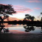 Grand African Villa, sunset overlooking the waterhole, Okonjima, Namibia