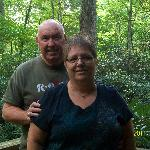 Standing on Porch at Misty Creek Log Cabin