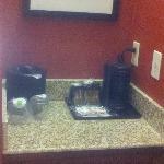 alcove with coffee station & mini fridge