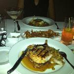 stuffed pork chop with sausage and the amazing grilled bass over gazpacho