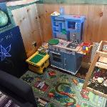 kiddo area with chalkboard, legos, kitchen and stuffed animals. The kitchen doubles as our emplo