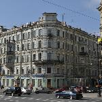 The corner of Nevsky pr. and Karavannaya st., the entrance to the hotel is on the right side.
