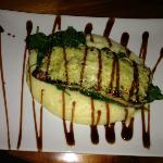 Parmesan encrusted salmon over garlic mash w/ citrus pesto & balsamic rdx