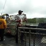 Guides pulling up crab pot