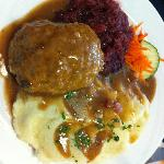"""Hackbraten"" which is homemade oven baked meatloaf with bacon gravy & mashed potatoes & red cabb"