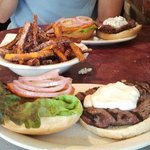 Kangaroo burger in front, Ostrich in back. Sweet potato fries in the middle.