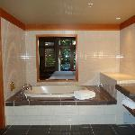 Soaker tub with pass through to room (there is a slider for privacy)