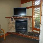 Great corner fireplace and tv with movie selection if you desire