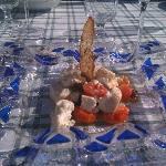ricottina calda di Colle S. Lucia con olive taggiasche e pomodorini