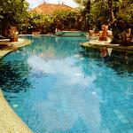 large outdoor pool surrounded by the private villas