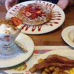 strawberry waffle, yogurt parfait and kids eggs n bacon