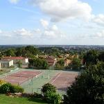 The plain below the hill, and the hotels tennis courts