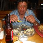 my hubby eating his oysters