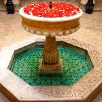 another courtyard fountain decorated with rose petals