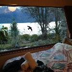 Huge window with view of the lake and mountains