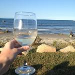 Enjoy your complimentary wine while sitting on the porch or beach