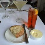 excellent bread, the cocktail on the right is a Pink Saphire