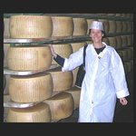 Elisabetta in a Parmigiano cheese warehouse