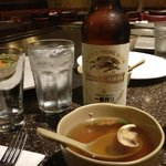 Part of a tasty Genji dinner. Hot soup and cold beer.