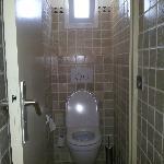 Nice tiles but very cramped toilet