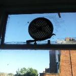 Cellotaped windows with a non working fan