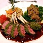 New Zealand Rack of Lamb Crusted with Garlic, Rosemary, and Bread Crumbs Over a Cabernet Reducti