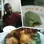 My bf enjoying veggie dumplings and Walnut Shrimp entree'!