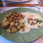 Soft melted cheese marinated with the nut oil and basil, served with the roast potatoes