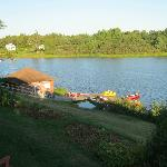 View from cabin of lake and boathouse and boats