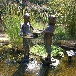 This is a bronze statue found in the Polliwog Pond at the Downing Children's Garden.