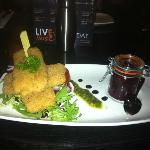 Breaded Brie and cranberry sauce